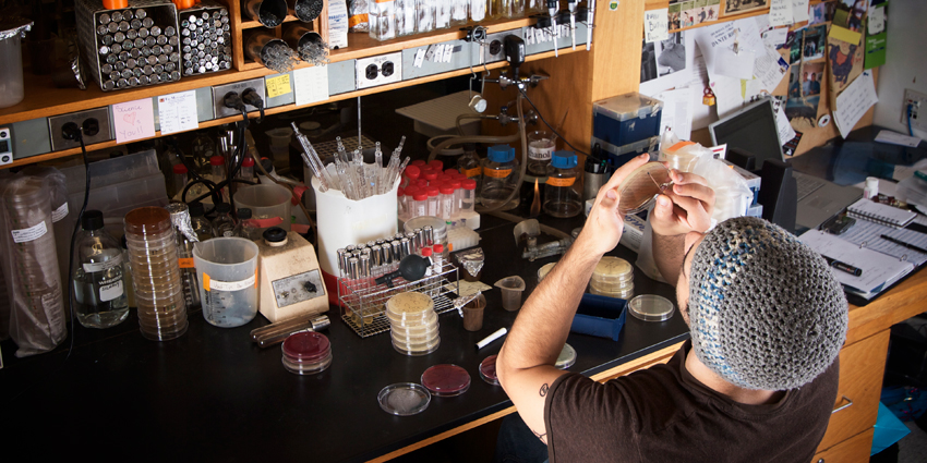 Photo of postdoc in lab environment.